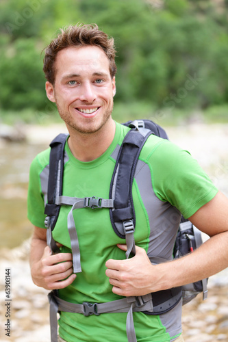 Active man portrait of sporty guy hiking outdoors