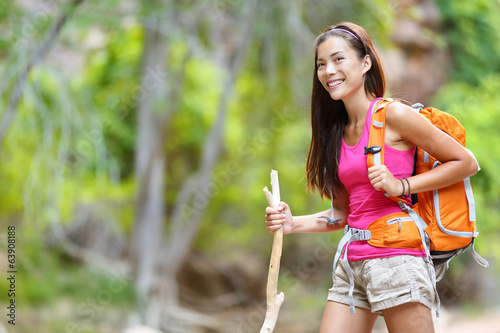 Asian woman hiker hiking in forest