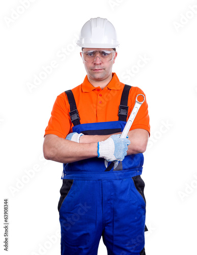 Worker in uniform with wrench isolated