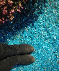 boots in blue gravel