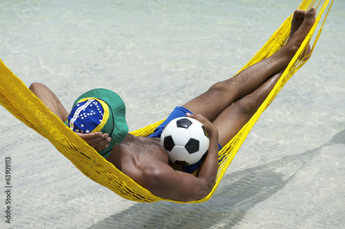 Brazilian Soccer Player Relaxing in Beach Hammock