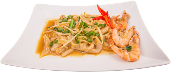 A plate of char kway teow with prawns and gravy