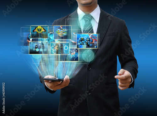 businessman holding smartphone technology and social media