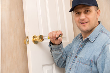 Locksmith installs lock