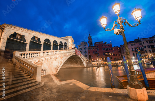 VENICE, ITALY - MAR 23, 2014: Rialto Bridge at sunset with touri
