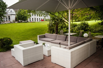 Modern fashioned patio cafe lounge in a green summer park