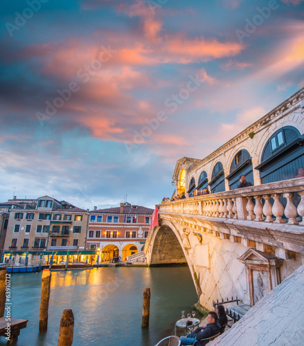 Wonderful wide angle view of Rialto Bridge on a cloudy sunset -