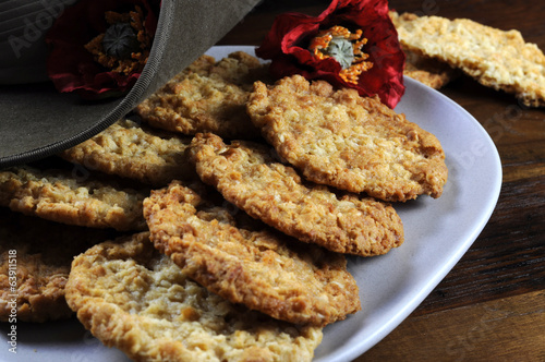 Australian Anzac biscuits on recycled wood. Close up.