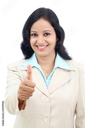 Young businesswoman showing thumbs up isolated against white bac