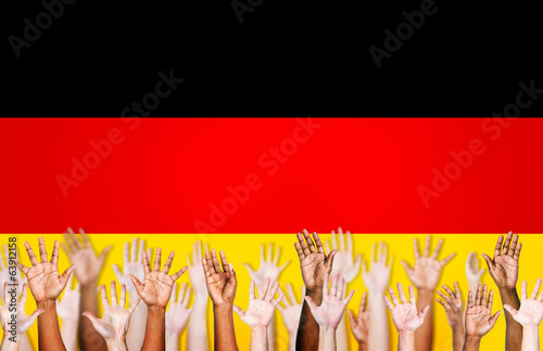 Group of Multi-Ethnic Hands and Flag of Germany