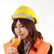 Engineer woman with orange Juice