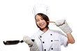 Young and happy beautiful girl cooking