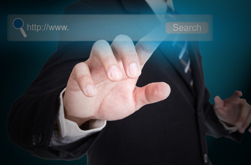 Businessman touching button for search