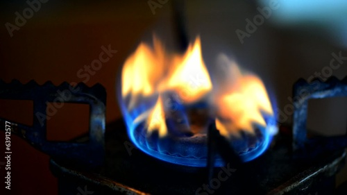 Natural gas in old and rusty portable stove burner.