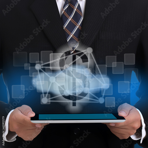 Businessman holding touch pad for network money concept