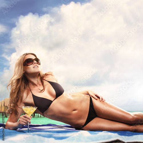 Beautiful Sexy Blond Woman Drinking Cocktail By The Sea