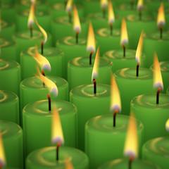 Closeup of burning many candle isolated on black background