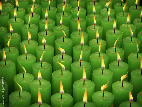 Closeup of burning many candle isolated on black background