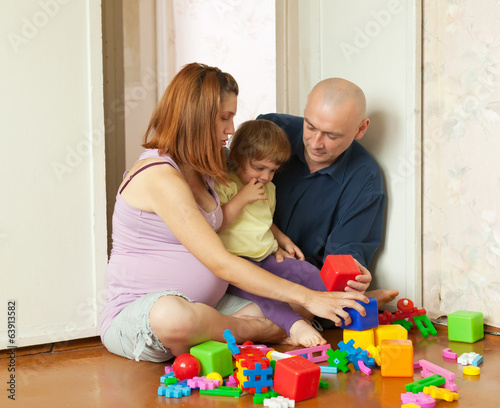 Happy parents plays with child