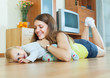 happy mom with child on wooden floor