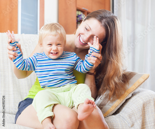Portrait of happy mom with toddler