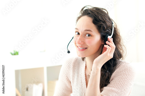 Portrait of young business woman working at home