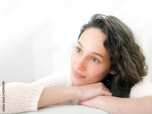 Portrait of an attractive thinking girl with curly hair