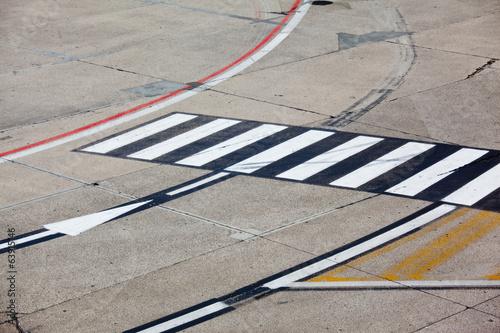 road symbol on runway airport - 63915146