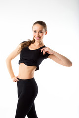 Young sexy athletic woman in black sportswear - isolated on whit