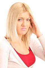 Blond woman experiencing a headache