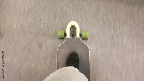 Shot on a longboard from the perspective of the longboard rider