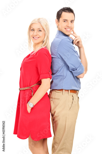 Young couple facing opposite of each other