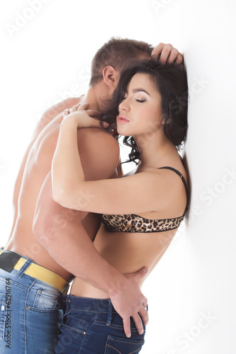 Passionate young lovers embracing in studio