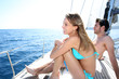 Lucky couple relaxing on sailboat deck