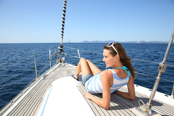 Woman relaxing on sailboat deck