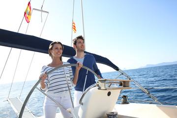 Couple sailing on the mediterranean sea