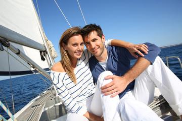Couple enjoying cruising on sailboat