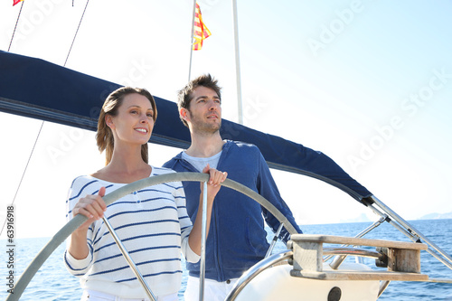 Couple sailing on the mediterranean sea