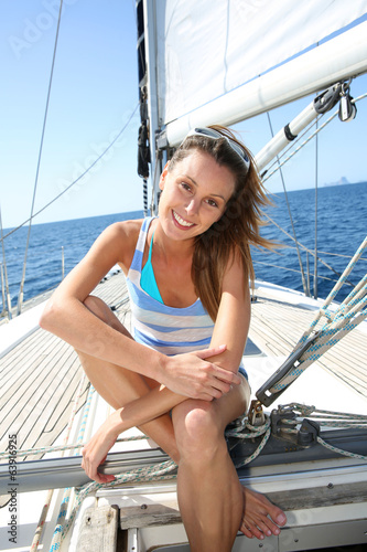 Portrait of cheerful girl on sailboat