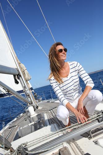 Fototapeta Attractive modern woman enjoying sailing cruise