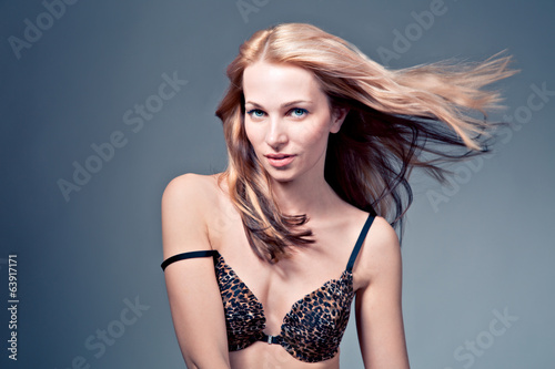 beautiful  blonde female model on blue background