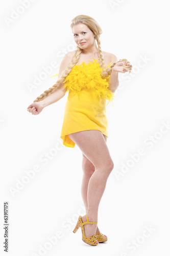 Young Woman with Long Blond Hair in Yellow Dress.