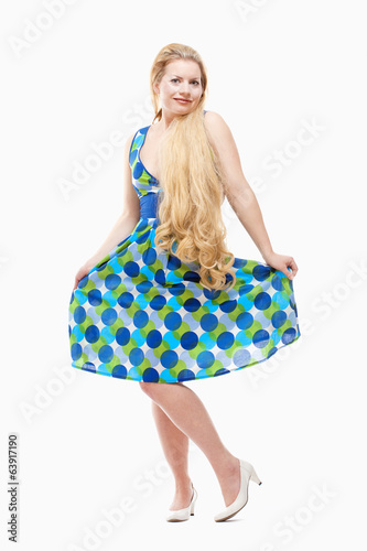 Woman with Long Blond Hair in Summer Dress.