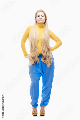 Young Woman with Long Blond Hair, Yellow Dress and Large Blue Eg