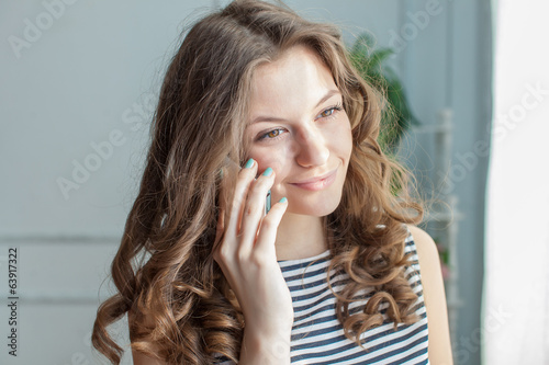 Young woman is speaking on the phone