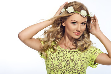 beautiful blonde girl in wreath of flowers