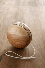 Wooden Yo yo and old fashioned childhood concept