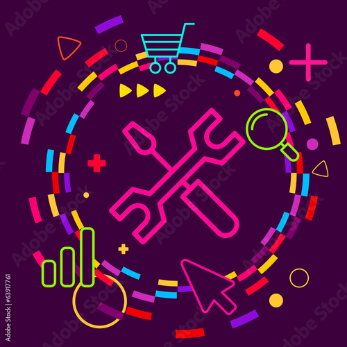 Screwdriver and wrench on abstract colorful geometric dark backg