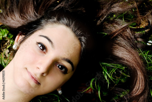 portrait of beautiful young girl with black eyes and long black