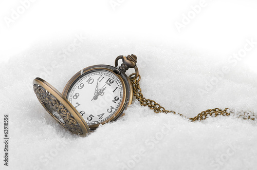 New Year's backgrounds .pocket watch in the snow